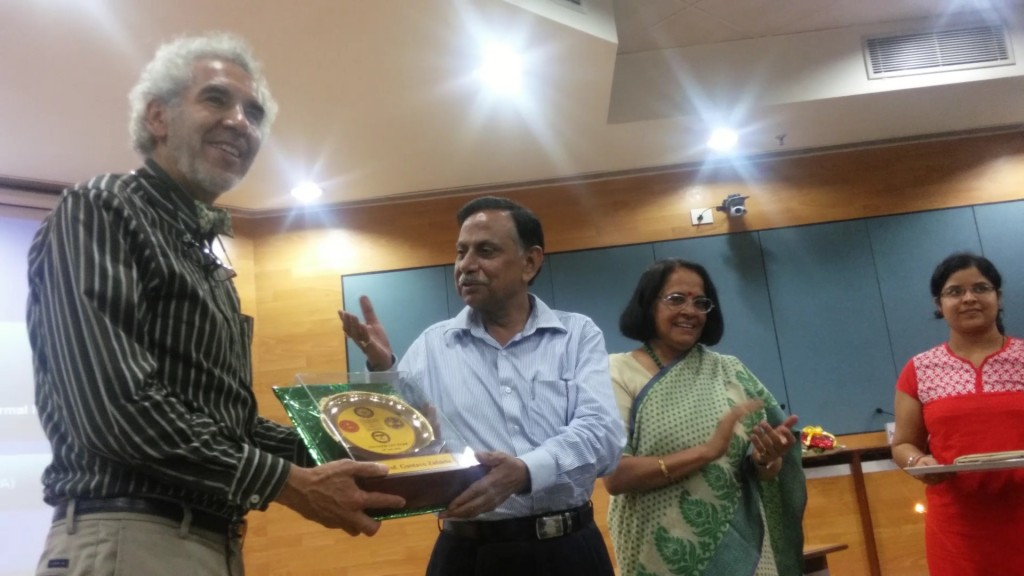 Chancellor Prof. S.N. Gaur, hands Dr. Zubieta a commemorative gift from Dipas.