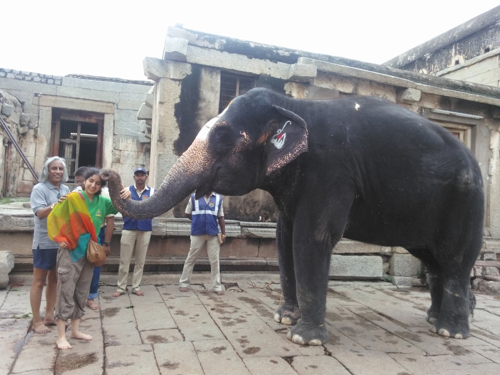Rafaela being blessed by the elephant in one of the temples near Hampi