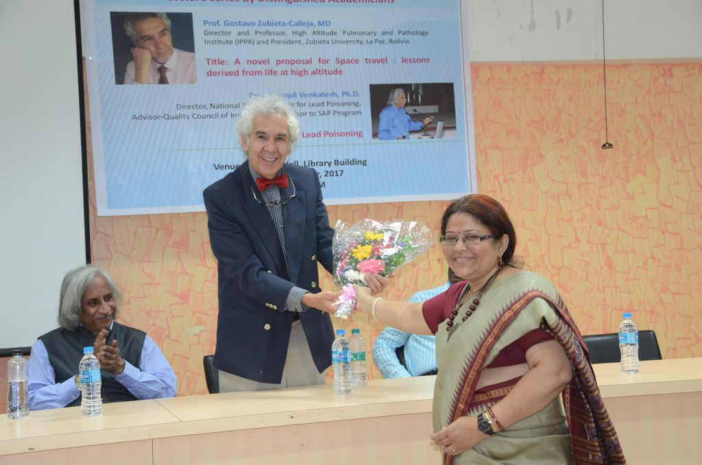 Receiving the flowers from Prof. Swastika Das, prior to the talk.